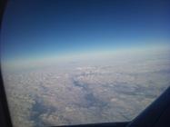 varfurile fagarasului vazute din avion printre nori